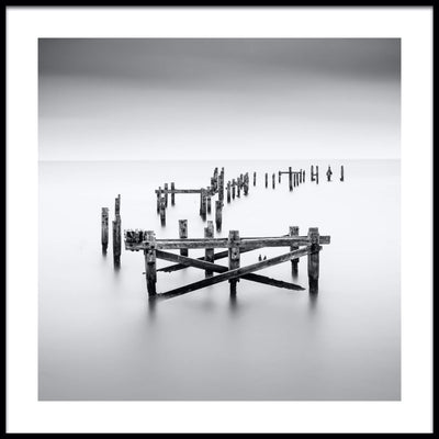 Vossington wall art and fine art photography of an ocean scenery with a decayed pier in a peaceful sea