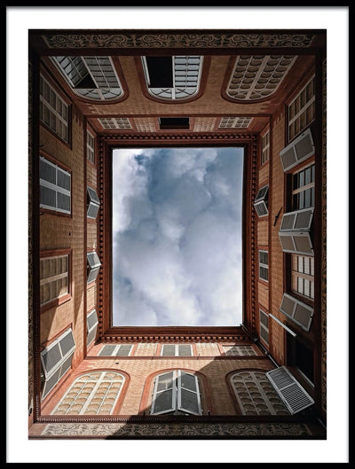 Vossington wall art and fine art photography of an Italian courtyard with a cloudy sky