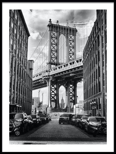Vossington wall art and fine art photography of an alley view of the Manhattan Bridge with a glimpse of the Empire State Building in New York City in the background