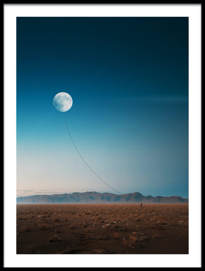 Vossington wall art and fine art photography of a lone wanderer in a desert holding the moon by a string like a kite in the sky