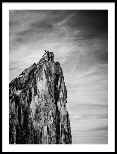 Vossington wall art and fine art photography of a mountain scenery with a hiker reaching the summit of a steep cliff after a long adventure