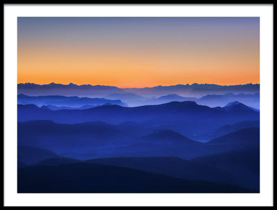 Vossington wall art and fine art photography of a mountain scenery with layers of dreamy foggy mountains just after sunset