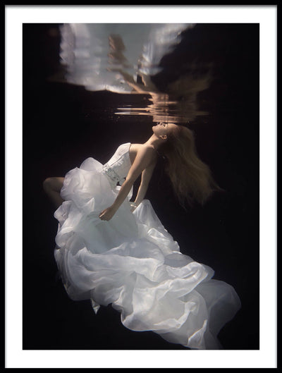 Vossington wall art and fine art photography of a graceful underwater model floating in a fashionable bridal dress reflected in the water surface