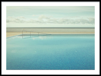 Vossington wall art and fine art photography of an empty swimming pool with a calm surface of water and small tiles at the bottom