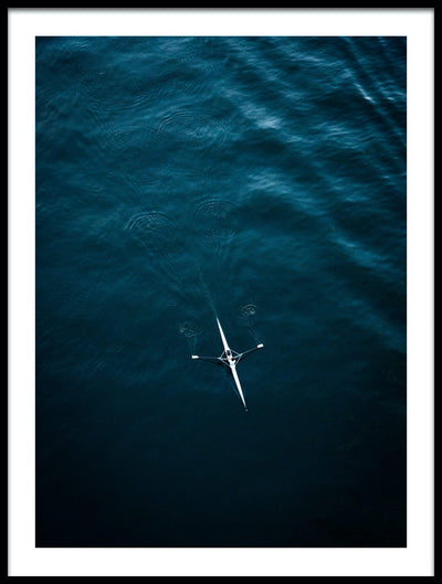 Vossington wall art and aerial photography of someone kayaking on a calm and peaceful ocean