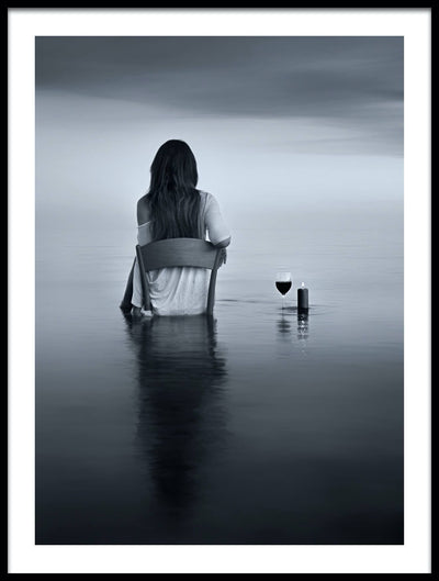 Vossington wall art and fine art photography of the back of a woman sitting on a chair in the ocean drinking a glass of wine