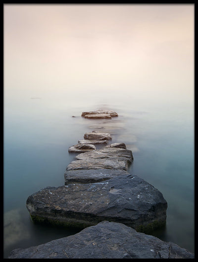 Vossington wall art and fine art photography of a pier of stones reaching into the water in a peaceful ocean landscape
