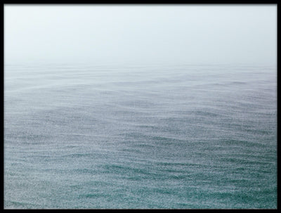 Vossington wall art and fine art photography of a minimalist empty ocean with fine rain and waves appearing out of the sea mist
