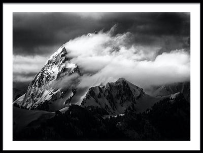 Vossington wall art and fine art photography of a strong wind blowing over a majestic snowy peak in an alpine mountain scenery