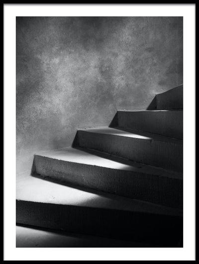 Vossington wall art and fine art photography of the steps of a spiral staircase with patches of light and shadow leading upwards