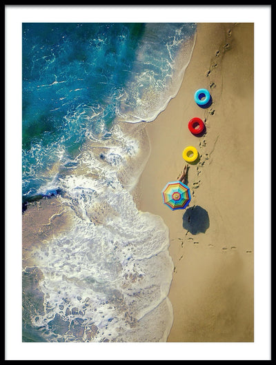 Vossington wall art and fine art photography from an aerial point of view of a tanning beach girl hiding under a colorful parasol on her summer vacation