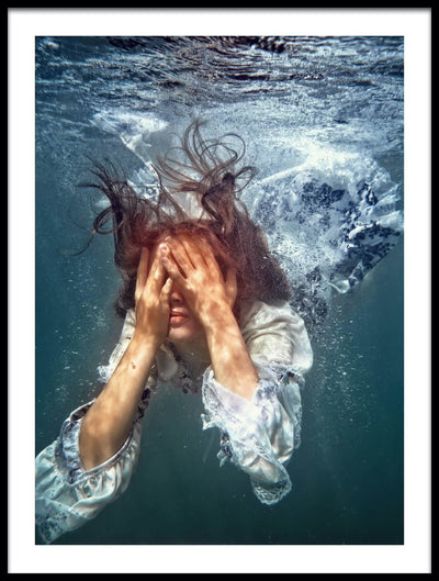 Vossington wall art and underwater photography of a girl diving into the water wearing a dress and covering her face with her hands