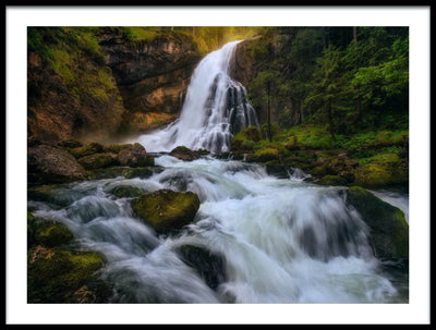 Vossington wall art and fine art photography of a flowing waterfall in a forest scenery