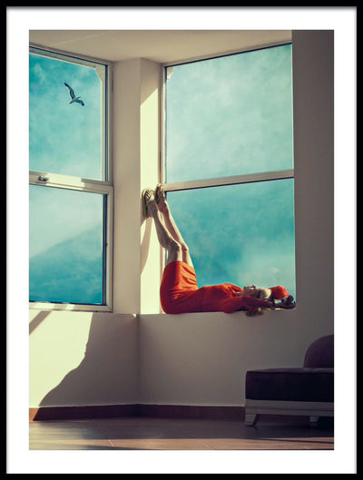 Vossington wall art and fine art photography of a woman with a red dress lying in a large window