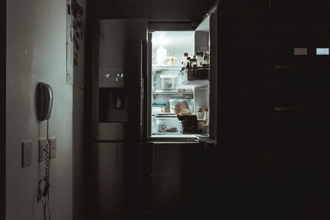 wiping  interior and exterior of  fridge