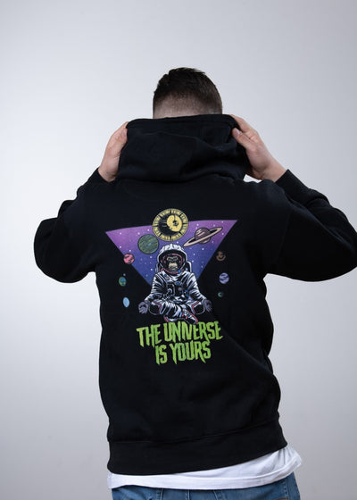 black hoodie with colorful retro backprint showing a space monkey and the nine planets of our solar system