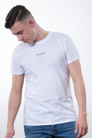 "white t-shirt with the text ""center of attention"" on the chest"