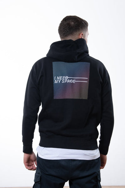 "black nineplanets hoodie with colorful neon backprint showing the text ""I need my space"""