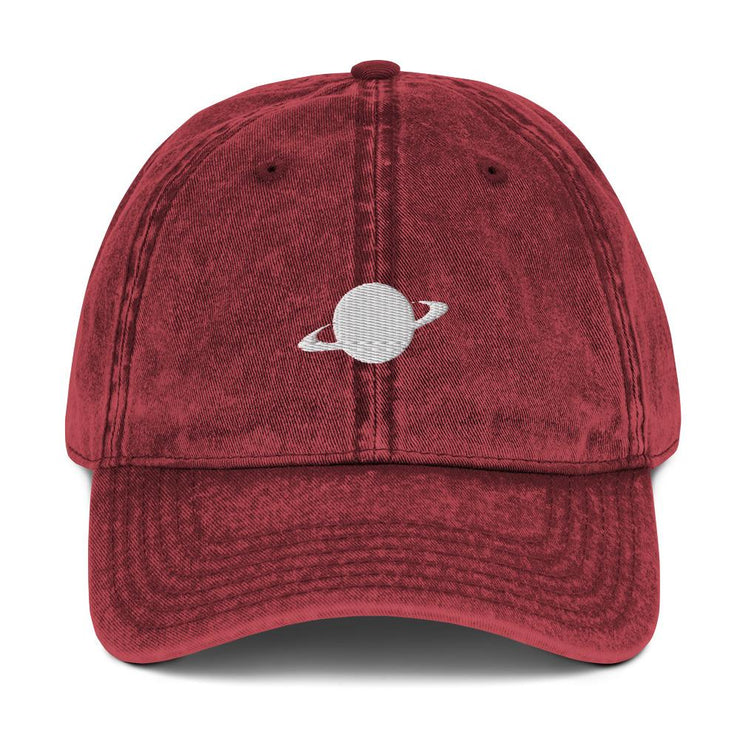 maroon cap with white saturn logo
