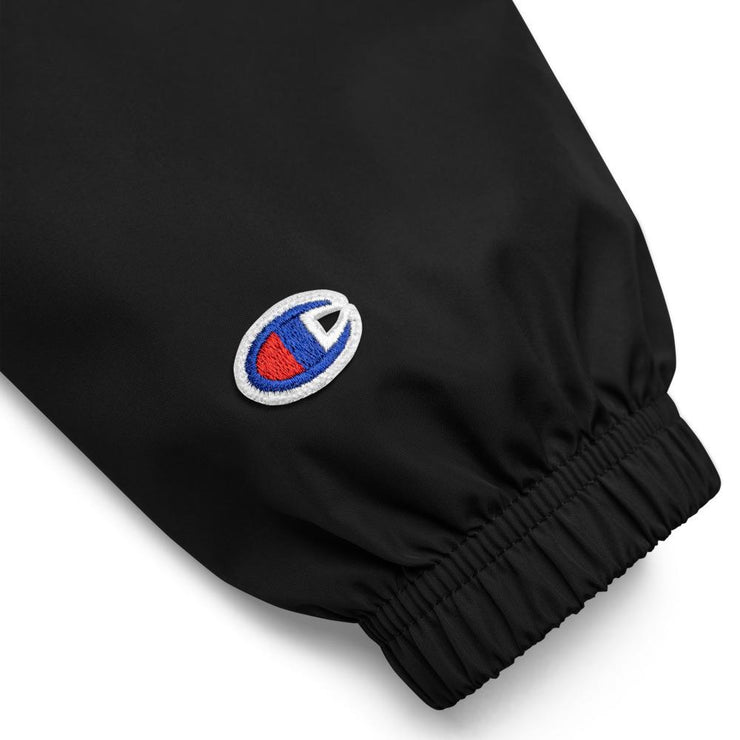 black sleeve of windbreaker jacket showing champion logo
