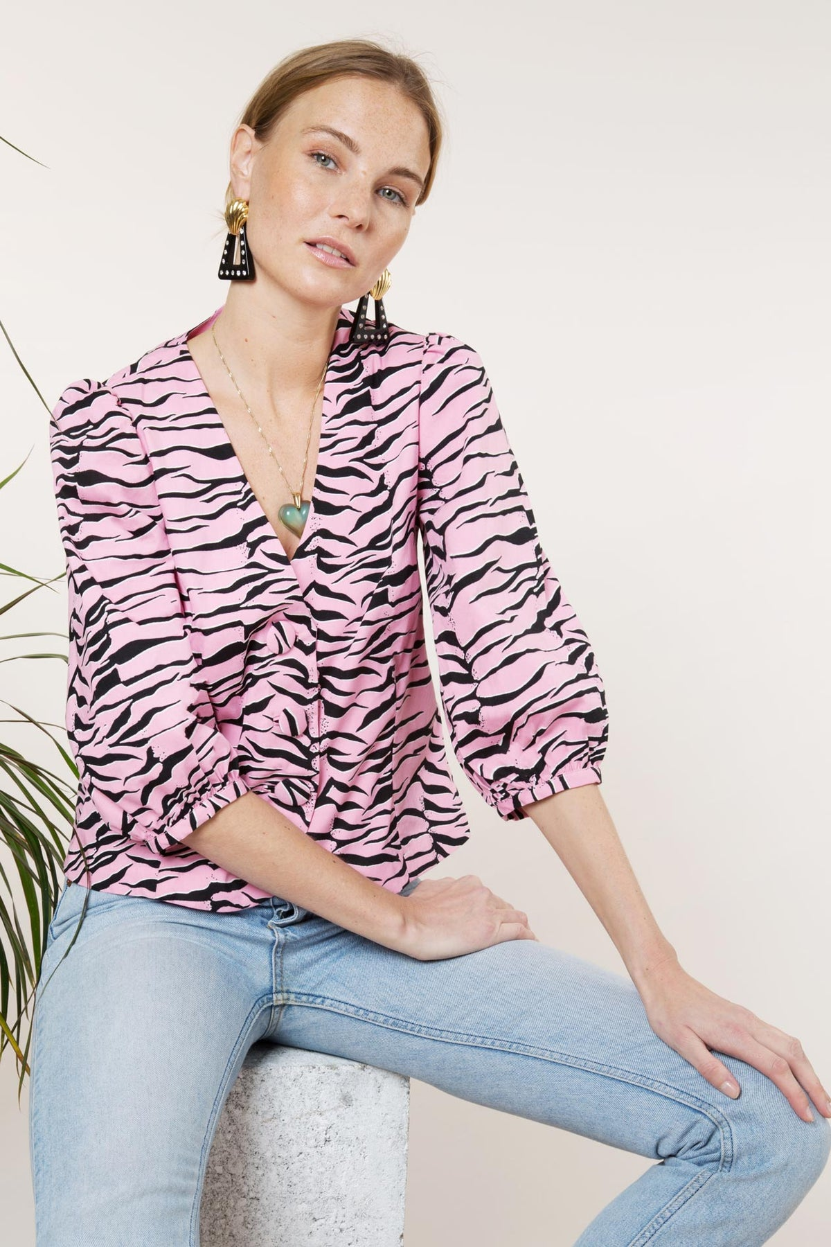 Woman wearing tiger-print Button Down Blouse/Jacket in baby pink from Rixo