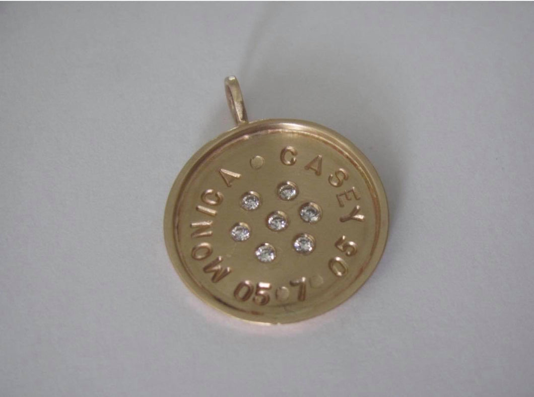 14k Gold Framed pendant with 7 Brilliant Diamonds