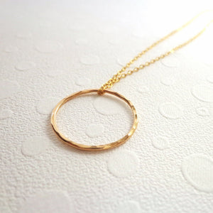 Gold circle karma necklace