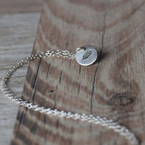 Silver disc feather necklace