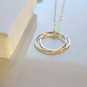 Two circle silver karma necklace