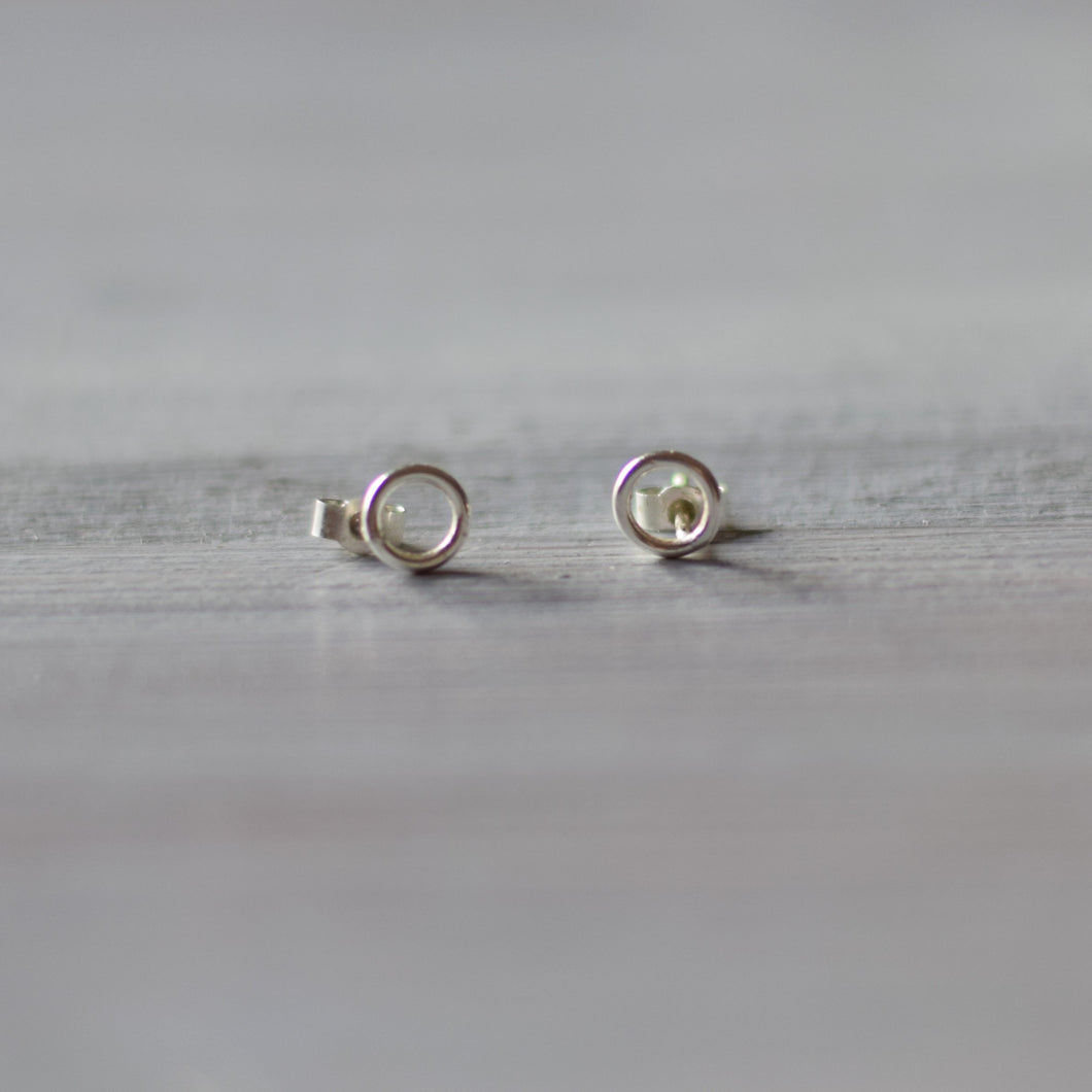 Round silver stud earrings