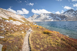 Fine photographic print of the Pacific Crest Trail meandering along a cold alpine lake in the High Sierra Mountain Range.