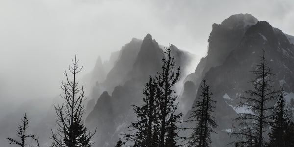 Fine Rocky Mountains National Park photography print of a misty layer covering the mysterious mountain peaks.