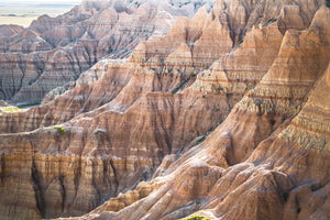 Fine photographic print of the painted ripples of the Badlands National Park landscape in South Dakota.