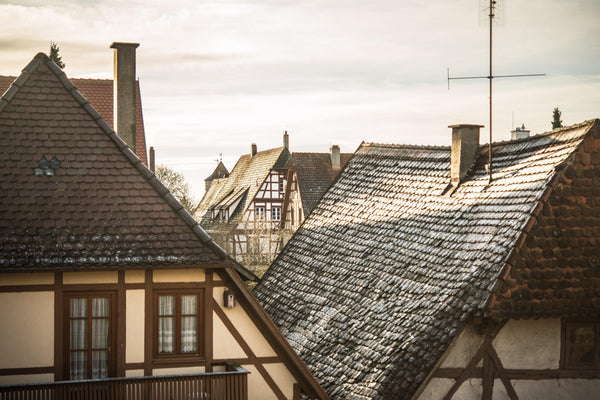 Fine photographic and art print of the morning sunlit rooftops of the Bavarian and historical town of Rothenburg ob der Tauber in Germany.
