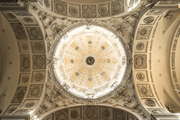 Fine photography print of the well-illuminated and ornately carved decorated dome of the Theatine Church in Munich Germany.