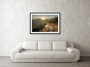 Framed fine photographic and wall art print of a sunrise highlighting the desert trail of the Pacific Crest Trail with mountains in the background.