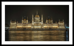 Framed fine photographic and art print of the Hungarian Parliament building in Budapest at nighttime with the light reflecting on the Danube River.