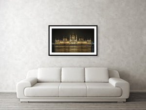 Framed fine photographic and wall art print of the Hungarian Parliament building in Budapest at nighttime with the light reflecting on the Danube River.