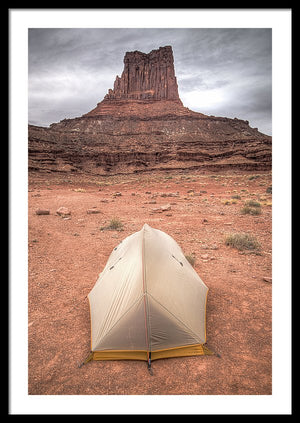 Framed fine photographic and art print of a small backpacker's tent in front of a red stone monument along Canyonlands National Park's White Rim Trail in Utah.