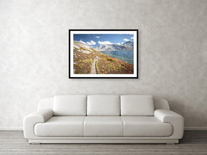 Framed fine photographic and wall art print of the Pacific Crest Trail meandering along a cold alpine lake in the High Sierra Mountain Range.