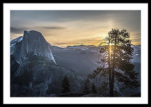 Framed fine photographic and art print of sunrise at Glacier Point in Yosemite National Park in California with Half Dome in the near distance and a tree in the foreground.