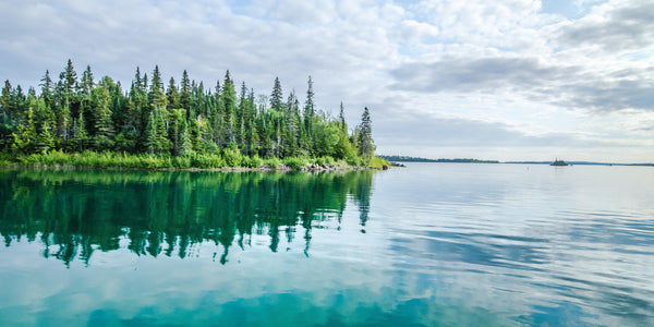 Fine photographic and art print of a vibrant green and blue serene and tranquil coastline of the Isle Royale National Park in Lake Superior Michigan.