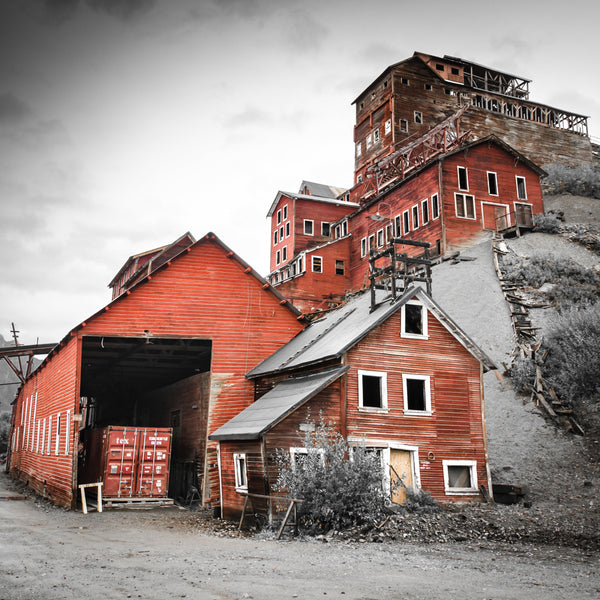 Fine photographic and art print of the towering red buildings of the Kennecott Mine in Wrangell St Elias National Park in Alaska.
