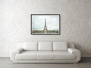 Framed fine photographic and wall art print of the Eiffel Tower in the distance with a cloudy backdrop over the landscape of Paris France.