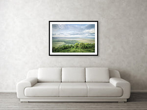 Framed fine Ngorongoro Crater photography and wall art print of the expansive crater atop the rim as the clouds breach the crater, casting shadows on the luscious landscape.