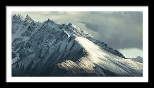 Framed fine photographic and art print of the Cathedral Peak in Denali National Park in Alaska with light and shadow perfectly highlighting mountain drama.