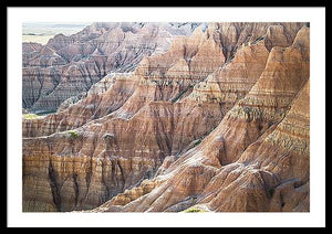 Framed fine photographic print of the painted ripples of the Badlands National Park landscape in South Dakota.