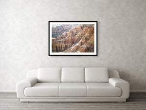 Framed fine photographic and wall art print of the painted ripples of the Badlands National Park landscape in South Dakota.