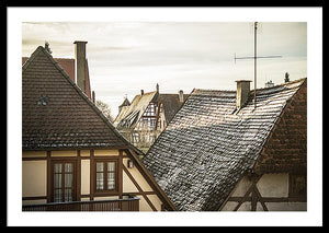 Framed fine photographic and art print of the morning sunlit rooftops of the Bavarian and historical town of Rothenburg ob der Tauber in Germany.