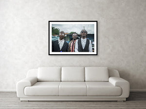 Framed fine sapeur photography and wall art print of three fashionable Sapeur men dressed up and strutting their clothes in Kinshasa, Democratic Republic of the Congo.